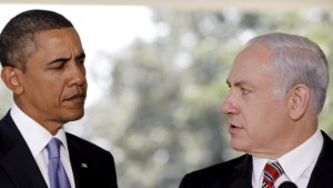 File photo of U.S. President Obama listening as Israeli PM Netanyahu delivers a statement in Washington