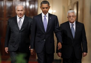 U.S. President Obama walks down Cross Hall with Israeli PM Netanyahu and Palestinian President Abbas to make joint statements at the White House
