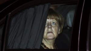 German Chancellor Merkel sits in her car after her arrival at the airport in New Delhi